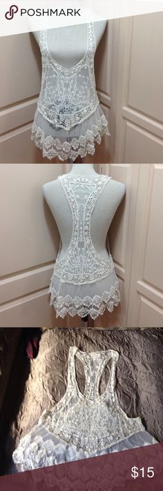 ELEGANT LACE COVER UP This can be used to go over a tank top to dress it up or used is a cover-up for a bathing suit.8/6 Tops Tunics