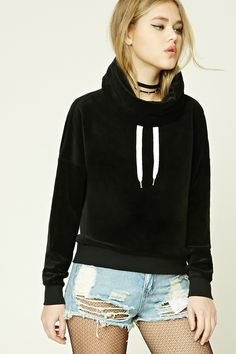 A velvet hoodie featuring a cowl neckline, contrast drawstrings, a billowy silhouette, and long sleeves.