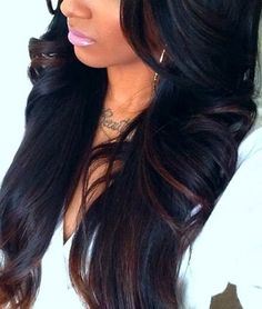Rich, black hair color with deep brown highlights.
