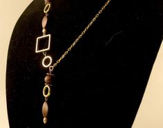 Gold and Brown Shapes Asymmetrical Necklace by BeadJewelledDesign, $25.00
