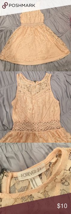 Lace Dress Light pink lace dress from forever 21. Size medium. Worn once for a wedding. Zipper on back. Perfect condition. Forever 21 Dresses