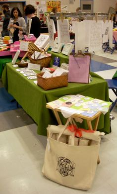 display ideas for the craft show. A stand like on the left would be good for prints.