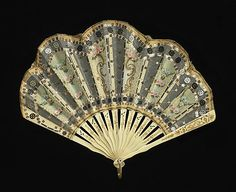 Circa 1910 ivory, silk, mother-of-pearl, and metal Fan by Tiffany  Co. Via Brooklyn Museum Costume Collection at The Metropolitan Museum of Art.