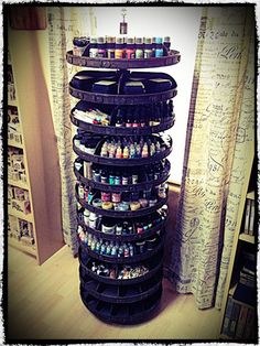 Tim Holtz finds an antique hardware spinner and transforms it to an awesome mixed media supply storage! So cool!
