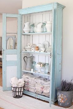 Love the pitchers and the shabby chic cabinet