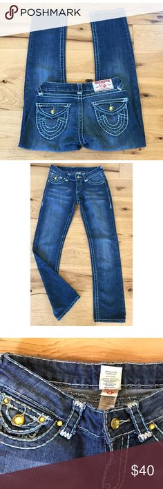"""💯 True Religion Jewels Signature Logo Pocket Jean In excellent pre-loved condition 100% authentic True Religion Jan in size 26. Made in the USA. Features flap pockets with True Religion signature logo. Yellow rhinestones details on the back pockets and in front near the pockets area. Light blue stitchings. Measure about 38"""" length, 7.25"""" leg opening, 29"""" inseam, 7.5"""" rise, 14"""" waist. 100% cotton. ❌No trades or modeling. Open to reasonable offers. Thank you‼❌ True Religion Jeans Straight Leg"""