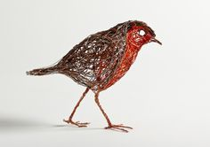 Bird Sculptures Constructed from Wire by Celia Smith look like Detailed Sketches. Robin, 12cm tall. Copper wire and telephone cabling.