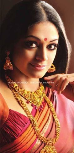 South Indian bride. Temple jewelry. Jhumkis.Red silk kanchipuram sari.Braid with fresh jasmine flowers. Tamil bride. Telugu bride. Kannada bride. Hindu bride. Malayalee bride.Kerala bride.South Indian wedding. Shobana