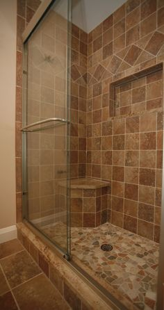 We used Porc DiRoca Breccia tile in jasper for the shower walls and accented… Standing Shower, Shower Tile Designs, Glass Shower Doors, Shower Walls, Glass Doors, Shower Remodel, Remodel Bathroom, Bathroom Interior Design, Bathroom Renovations