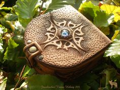 Jeweleeches Vivian Hebing handmade leather coin purse with a little glass cabochon! You can also find me on facebook or Etsy! Or my webshop: www.jeweleeches.nl