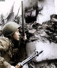 Soviet soldier peers through his trench periscope on the Leningrad Front | by Za Rodinu