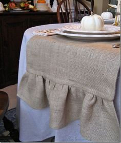 love the table cloth -- looks great with the solid white and would look awesome with my patterned plates!
