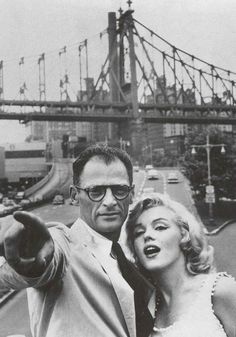 NYC. Marilyn Monroe and Arthur Miller in New York with 59th. Street Bridge in the background, photographed by Sam Shaw, 1957.