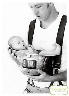 Firefighter baby photos - Project Wedding Forums....Except with Justin in a hockey jersey and holding her in his goalie glove.