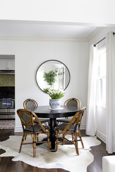 A petite dining situation is the perfect solution for this cozy two-bedroom. Here, classic French bistro chairs from Maison Midi surround a black Avalon round dining table from Crate & Barrel. Black Round Table, French Bistro Chairs, California Cool, Interior Decorating, Interior Design, Patio Chairs, Dining Chairs, Blue Chairs, Lounge Chairs