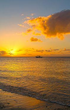 Sunset in yellow - Mauritius.   ASPEN CREEK TRAVEL - karen@aspencreektravel.com