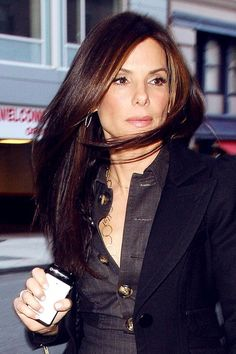 Sandra Bullock is spotted in New York with windswept hair and a long black coat, as she makes her way inside a building. Bullock is currentl...
