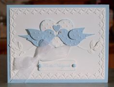 """This cute handmade wedding card measures 5 1/2"""" x 4 1/4"""" and was made using Stampin' Up stamps, card stocks, inks, embossing folders, punches, brads, craft pearls & organza ribbon. The hearts, birds & branches are embossed then punched. The edges of the large heart & the phrase have been lightly sponged."""