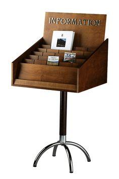 Portadepliant e informazioni in legno e ottone. Dim. 600x600x1200 mm