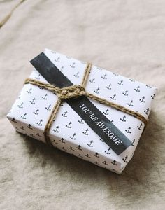 "Nautical gift wrap with anchor paper, rope and ""awesome"" tag."