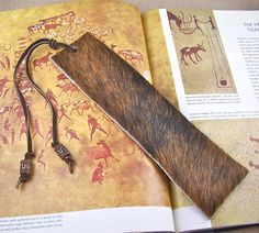 Bookmark Leather - Oversized Black & Brown Brindle Cowhide - Copper Plated Pewter Barrel Beads - $19.99, via Etsy. Nicely masculine.