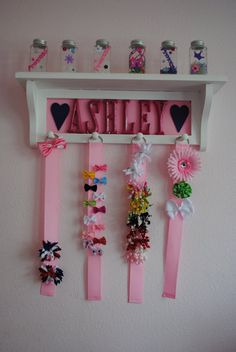 Custom bow storage shelf...this would work, but I need a spot for head bands too.