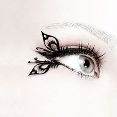paper eyelashes.....  I've never seen these before.... Would be nice for a costume occasion.