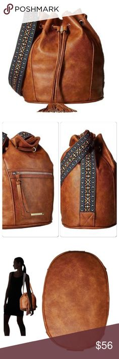 """Steve Madden Bruby Bucket Drawstring Bag This bag will complete your fall look! Cognac vegan leather with a beautiful embroidered strap and tassels on the drawstring. Fun patterned lining with one zip pocket and 2 slip pockets. 1 exterior pocket. Approx. measurements are: 12"""" H x 10"""" W x 7"""" D. Brand new with tags! ❌No trades Steve Madden Bags Shoulder Bags"""
