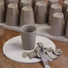 Cutting in the facets of the beakers. Once the foot has been turned I place them on a pre marked board to mark out were the cuts will be made. The tricky part in the making is leaving the pots a little thicker in the bottom half to give me enough clay not to cut a hole in the side of each pot. These beakers will be used for testing a range of new glazes. #ceramic #ceramics #make #craftmanship #craft #clay #pottery #studiopottery