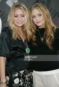 Actresses Mary Kate and Ashley Olsen arrive to the 2003 MTV Video Music Awards at Radio City Music Hall on August 28, 2003 in New York City.