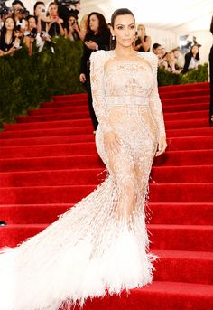 Kim Kardashian in a completely see-through embroidered and feather-trimmed Roberto Cavalli gown at the 2015 Met Gala