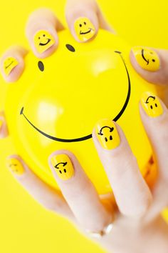 Use yellow nail polish, a black nail art pen and a steady hand to make this happy smiley face mani for spring and summer!