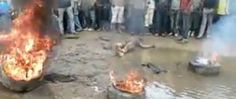 Graphic images show horrifying 'mob justice' in Cameroon. When people are caught stealing, they are either burnt alive or beaten to death by a large group of people. The population of the country is very intolerant of stealing. Death, Politics, Scene, Group, Country, People, Image, Rural Area, Country Music
