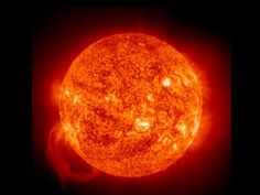 An enormous magnetic loop of hot gases creates a glowing handle on the sun. The June 9, 2002, prominence was caused by explosive instabilities in the sun's magnetic field