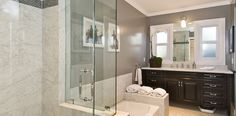Gorgeous bathroom with windows substituting mirrors over extra-wide black vanity with white marble countertop, charcoal gray wals, marble drop-in tub next to glass walk-in shower with marble shower surround. Bathroom Inspiration, Small Bathroom, Gray Painted Walls, Modern Bathroom, Bathrooms Remodel, Home, Gorgeous Bathroom, Bathroom Design, Jeff Lewis Design