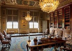 Library. Vaux le Vicomte, Maincy, France. 17th-century chateau for Nicolas Fouquet. Tortoiseshell and brass-plated ebony bureau plat, Louis XVI mahogany bookshelves, Louis XIV armchairs with Genoese-style embroidery, Savonnerie rug.  Designer: Charles Le Brun.