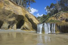 Located near Cannon Beach, Hug Point is a unique hidden beach with a stunning waterfall pouring right onto the sand. A short, scenic hike will lead you to this lovely destination.