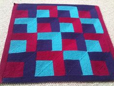 Cousins Mitre Square Baby Blanket by Emily Pain - this pattern is available as a free Ravelry download.   Note  Emily Pain