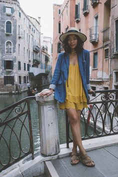 @honeynsilk explores Venice in our gold collar necklace and lace-trimmed yellow romper. | H&M OOTD
