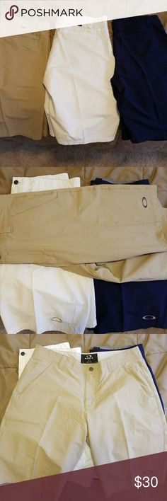 3 pair Men's Oakley shorts.  36 waist. New without tags.  Lightweight material.  Blue, khaki, white.  All 3 for 30.00. Oakley Shorts Hybrids