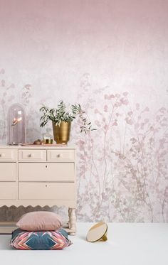 Interior image of the Flown - Rose Ash wallpaper from Mr Perswall. This wallpaper depicts a dreamy summer meadow with plants and leaves in a variety of dusky pink tones.