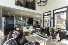 Masters of Flip luxe lodge living room, kitchen, dining room and overhead balcony Masters Of Flip, The Middle, Flip Or Flop Hgtv, House Flippers, Living Area, Living Room, Home Bedroom, House Plans, House Design