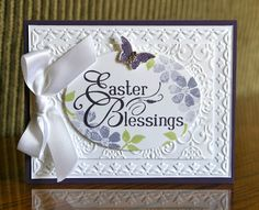 handmade Easter card ... white embossed layers topped with an oval framelit for the main image ... gorgeous satin bow ... large sentiment EASTER BLESSINGS as main image ,,, stamping off technique to get several tones  of the blossom from one inking ... Stampin' Up!