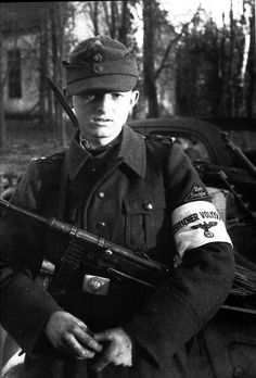 End of the line: 16-year old Volkssturm militia recruit poses for the photographer. His weapon is an MP-40 SMG. Volkssturm pulled in the very young and the quite old; both age groups were unfit for combat and were slaughtered accordingly. East Prussia, Oct 1944.