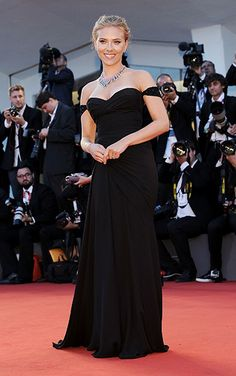 Scarlett Johansson was a vision on the red carpet in this navy off-the-shoulder dress by Versace. The perfectly tailored gown fits Scarlett's figure like a glove, offset only by a Bulgari necklace.