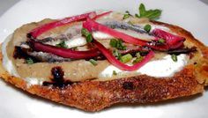 Black and white anchovies on toast with eggplant jam and goat cheese at El Colmado. (Photo by: The Food Doc)