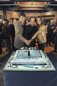 Stana Katic with Nathan Fillion and Andrew W. Marlowe at Castle's 100th episode cake cutting-ceremony