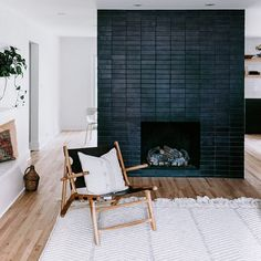 A Glazed Thin Brick fireplace in Black Hills became the focal point for this timelessly modern home designed by more of… Black Brick Fireplace, Home Fireplace, Fireplace Remodel, Fireplace Surrounds, Fireplace Design, Black Fireplace Surround, Fireplace Ideas, Black Brick Wall, Fireplace Modern
