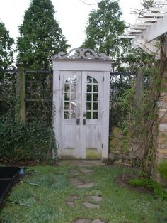 "garden doors instead of a gate. I love this, especially that they used the entire frame too. Very ""my secret garden"" :) Garden Gates And Fencing, Garden Arbor, Garden Paths, Arbor Gate, Terrace Garden, Garden Entrance, Garden Doors, Secret Garden Door, Entrance Gates"