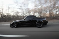 All Black Honda S2000!!  i love anything all black!!